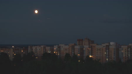 Moon and Night City. The moon moves in the night