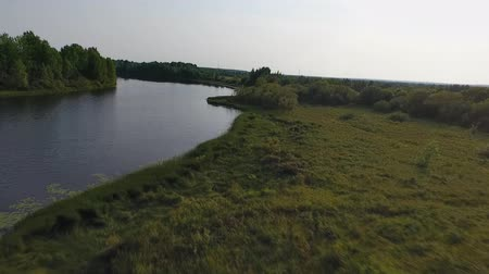 Flight over Lake. Video is from the drone flying over a field and a lake in the summer. Beautiful Northern nature