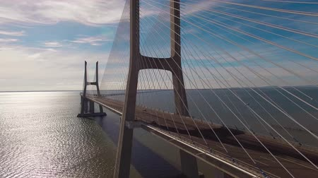 car traffic : Beautiful modern bridge over the river aerial view