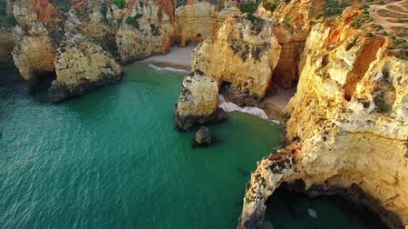 ponta da piedade : Ponta da Piedade on cliff near ocean at sunset, Lagos, aerial view Stock Footage