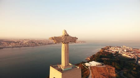 jezus : Statue Christ the King Cristo Rei Lisbon Almada at sunset aerial view Wideo