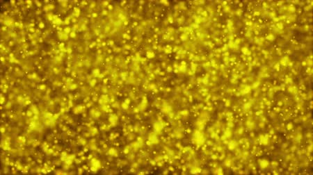 mléčný : Gold Particles. Natural Floating Organic Particles On beatiful relaxing Background. Glittering Particles With Bokeh. Slow motion.