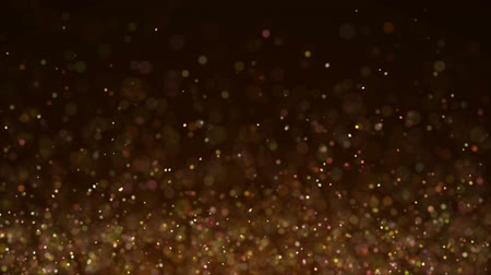 resting : Gold Particles. Natural Floating Organic Particles On beatiful relaxing Background. Glittering Particles With Bokeh. Slow motion.