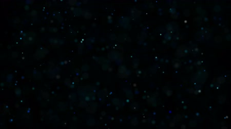 Dust Particles, random motion of particles.On beatiful relaxing Background. Glittering Particles With Bokeh in volumetric light Wideo