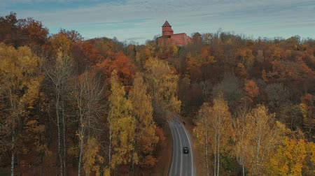 riga : Sigulda city autumn road car drive from above with the car Stock Footage