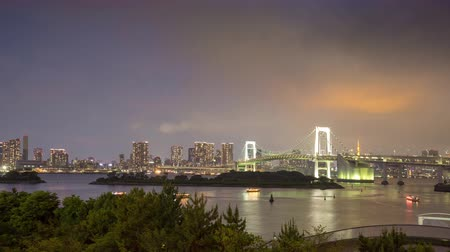 Tokyo bay and Rainbow Bridge dusk to night time lapse