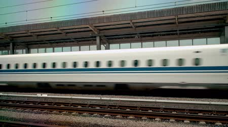 shinkansen : shinkansen, japanese bullet train, arrives at station platform