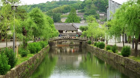 picturesque quarters : zoom in on stone bridge over canal in kurashiki historical quarter