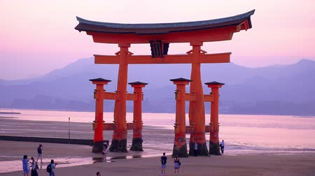 famous floating Torii gate with low tide, zoom out