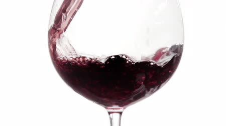 pouring red wine into glass isolated on white background. Stock Footage