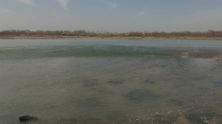 川岸 : Shallow water near bank of the river on spring day