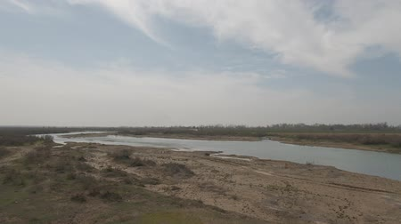 Panorama of the river in cloudy spring day