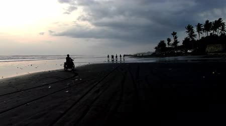 People on the ocean at high tide in Indonesia, Bali. Drone shooting.