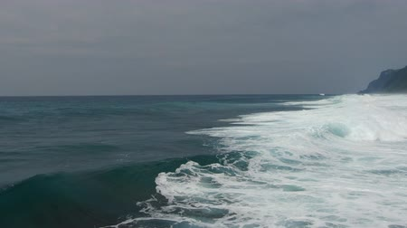 powódź : Foamy waves of the ocean surf at high tide in Indonesia, Bali. Drone shooting Wideo