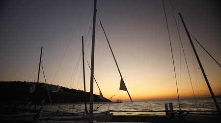 maravilha : Sailboats on the beach at sunset. Timelapse. Beautiful warm sundown.
