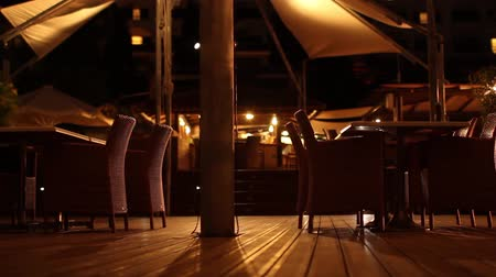 gray's : Brightly lit outdoors restaurant shot at night. Stock Footage