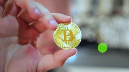mining farm : Crop hand showing golden bitcoin Stock Footage