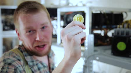 mining farm : Man looking at trying bitcoin with teeth