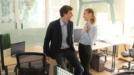 Couple flirting at workplace