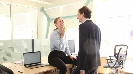 Couple laughing in office Стоковые видеозаписи