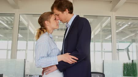 Loving couple in office Стоковые видеозаписи