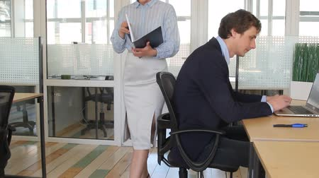Man looking at colleague ass Стоковые видеозаписи