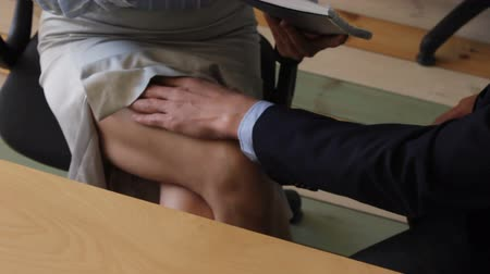 shameful : Woman being harassed in office Stock Footage