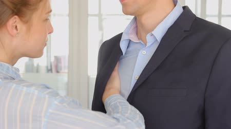 shameful : Young woman unbuttoning man shirt Stock Footage