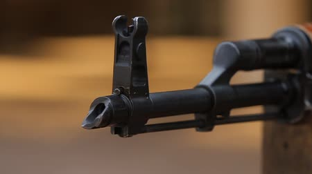 charged : Closeup of a flame arrester assault rifle, reloading and four shots. Stock Footage