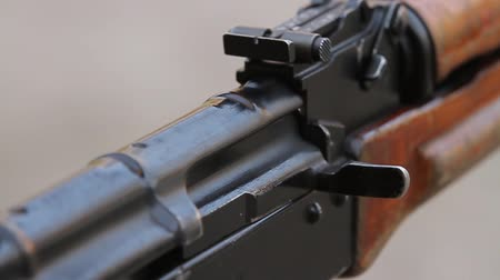 charged : Closeup of the shutter and rear sight  assault rifle, two shot. Stock Footage