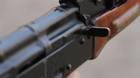 charged : Closeup of the shutter and rear sight assault rifle, one shot. Stock Footage