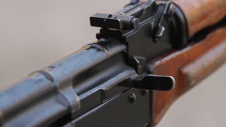 charged : Closeup of the gate and safety lock assault rifle, two shots in slow motion. Stock Footage