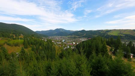 view of Verkhovyna settlement in the Carpathian mountains Ukraine, pan from left to right. Full HD, no sound.