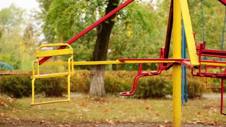 üres : motion of an empty childrens carousel. the carousel moves at a minimum speed clockwise and stops. autumn. full hd, no sound.