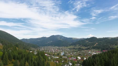 view of Verkhovyna settlement in the Carpathian mountains Ukraine, tilt from the settlement at the foot of the mountain to the sky. tilt from bottom to top. Full HD, no sound.