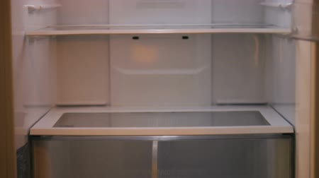 frig : Empty white refrigerator tilt down and up