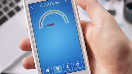 boletim : Checking credit score on smartphone using application. The result is GOOD