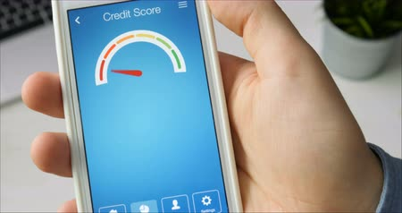 boletim : Checking credit score on smartphone using application. The result is NO CREDIT SCORE Stock Footage