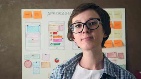 Portrait Young UX designer smiling in creative agency office