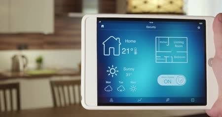 poplach : Turning on alarm system in the house using app on the digital tablet