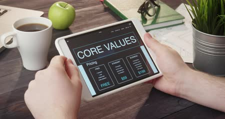 ethic : Reviewing core values internet page using digital tablet at desk Stock Footage
