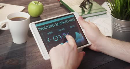 сообщить : Checking inbound marketing records using digital tablet at desk