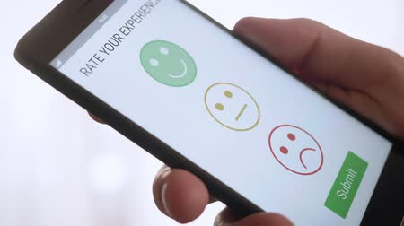 assess : Giving a positive feedback on customer satisfaction app using smartphone Stock Footage