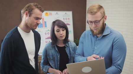 Team of young business managers analyzing data using computer in the office