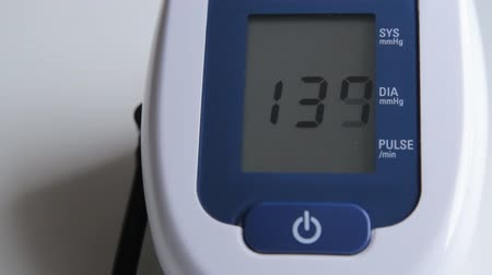 indicating : Blood pressure displayed on monitor close-up.
