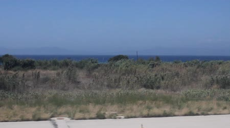 rhodes : Aircraft taking off close to the sea view from the window Stock Footage