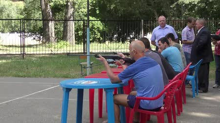 marksman : Orenburg, Russia - August 8, 2015: Men compete in shooting from a pneumatic