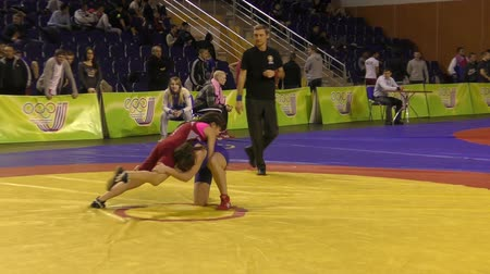 duruş : Orenburg, Russia - January 28, 2016: Girls compete in freestyle wrestling on Championships of Orenburg oblast girls 1999-2000 years of birth