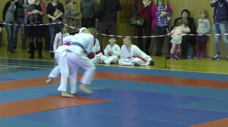 sztuki walki : Orenburg, Russia - February 13, 2016: Children compete in jiu-jitsu.