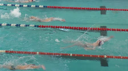 teen action : Orenburg, Russia - April 23, 2016: The boys compete in swimming on backstroke on City Championship